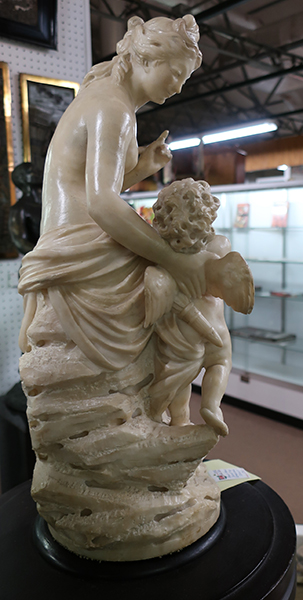 Carved Sculpture of Nude Woman with Angel