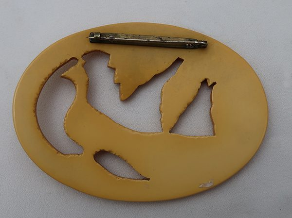 Vintage Bakelite Yellow Oval Carved Peacock Pin