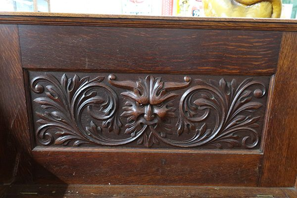Oak Hinge Lid Storage Bench with Carved Face