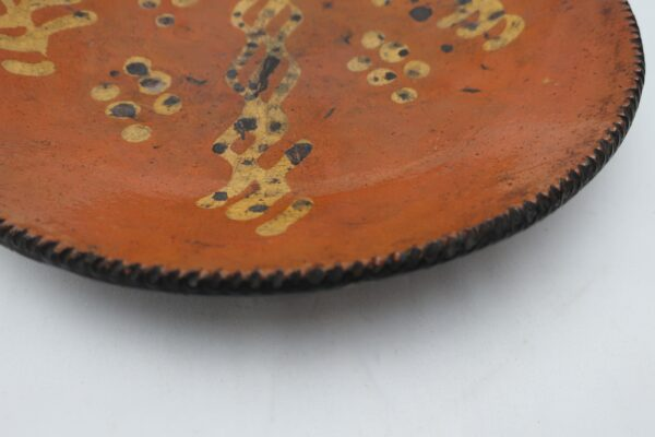 Decorated Pennsylvania Redware Plate with Eggshell Edge